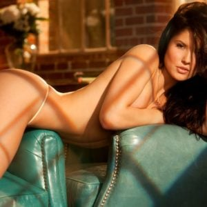 Amanda Cerny topless on a green couch