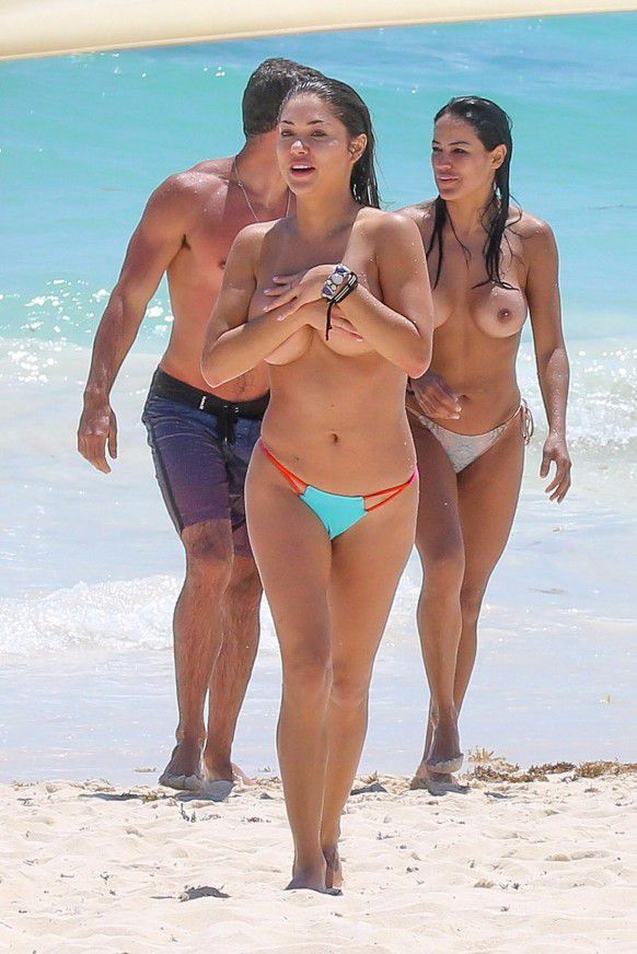 Arianny Celeste covering her boobs at the beach
