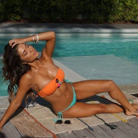 Arianny Celeste in her bikini by the pool showing off her tan