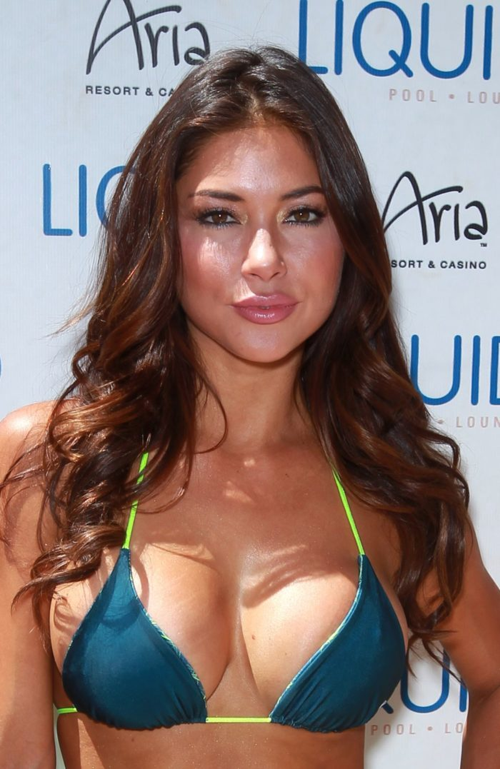 Arianny Celeste showing her cleavage in bikini top