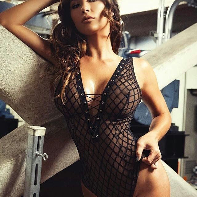 Arianny Celeste wearing see through lacy body suit