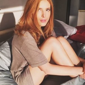 Bella Thorne sitting on bed with no pants on