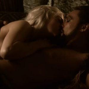 Emilia Clark naked laying next to man