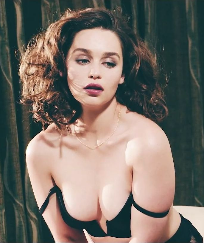 Emilia Clarke showing cleavage wearing a off the shoulder top