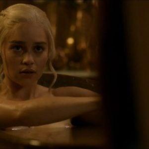 Emilia Clarke sitting in bath tub nipple peaking out of water