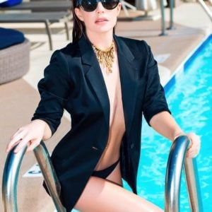 Jillian Murray climbing out of pool topless in a black blazer