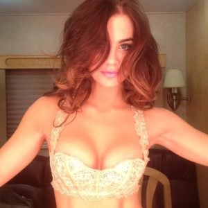 Jillian Murray wearing a yellow bra exposing cleavage