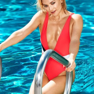 Kate Hudson climbing out of pool in red swimsuit