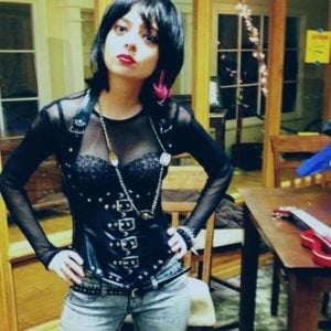 Kate Micucci in a mesh leather top and pink earings
