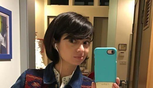 Kate Micucci taking a bathroom selfie in a jean jacket