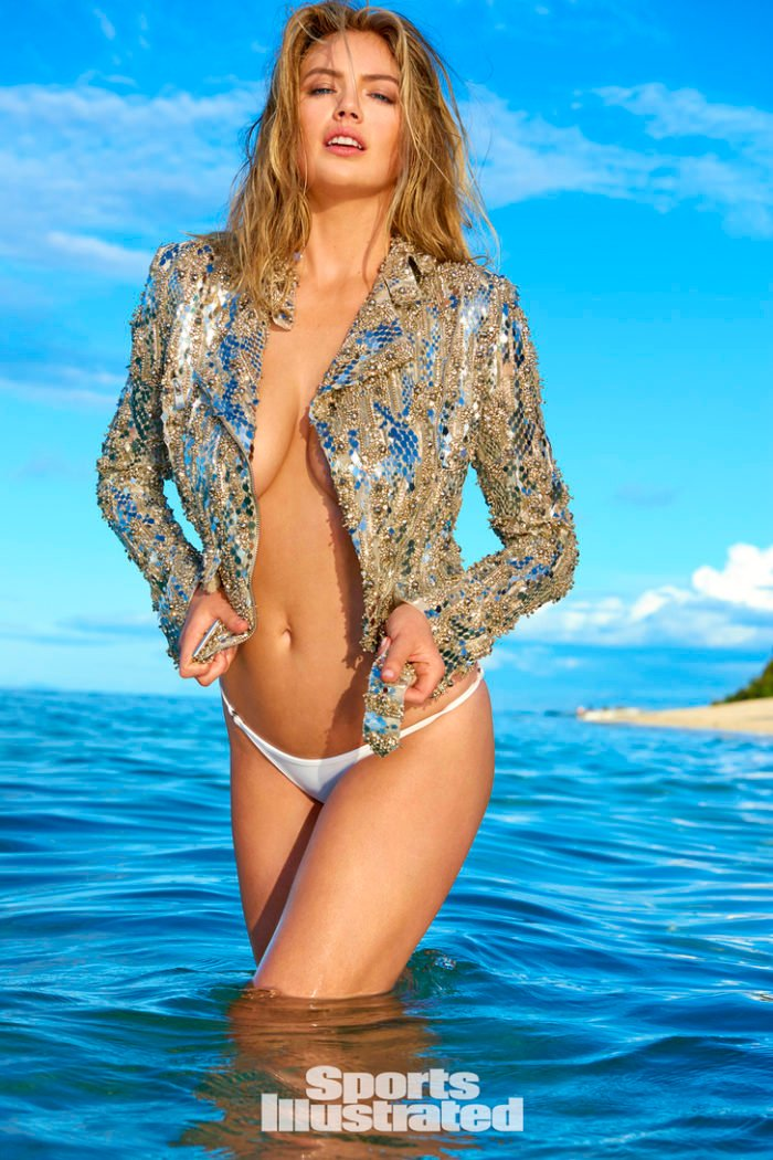 Kate Upton in Fiji waters modeling with a sparkly jacket and white bikini bottoms