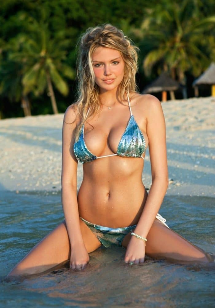 Kate Upton in a blue sparkly bikini on her knees