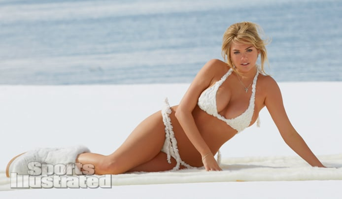 Kate Upton laying on snow in bikini