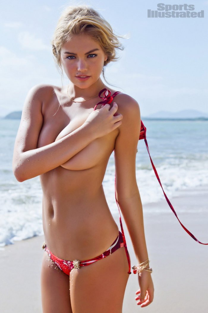 Kate Upton topless covering her boobs in 2012 SI