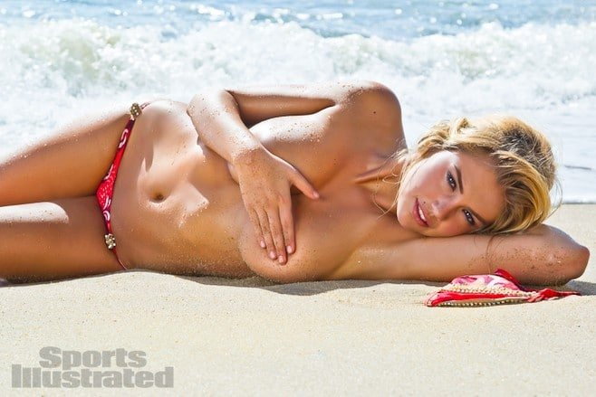 Kate Upton topless laying on the sand in 2012 Sports Illustrated photo shoot