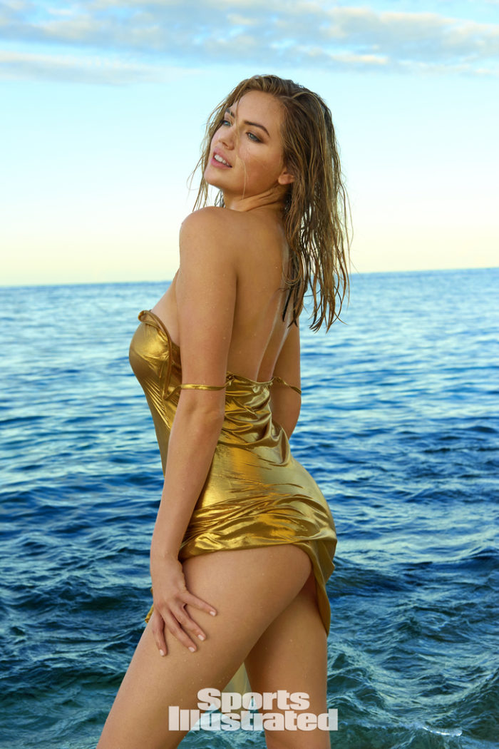 Kate Upton wears a golden one piece suit in the ocean