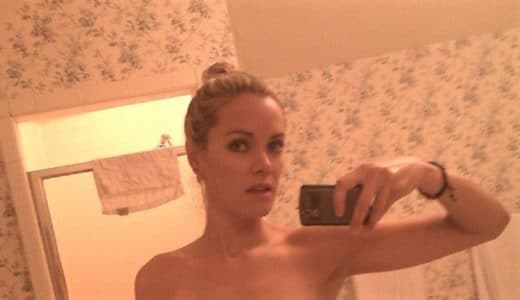 Kristanna Loken with a bun takes a mirror selfie