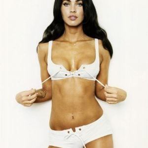 Megan Fox in a white bikini holding strings