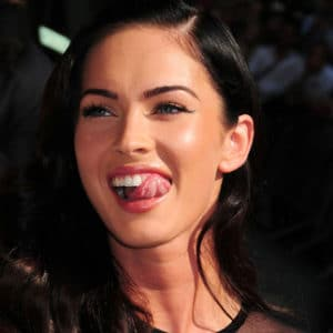 Megan Fox licking her teeth with her tongue