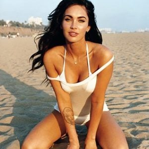 Megan Fox spreading her legs on the beach in white tank top
