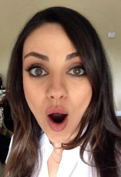 Mila Kunis with her mouth open