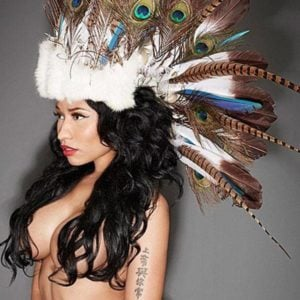 Nicki Minaj modeling topless with indian feathers on her head
