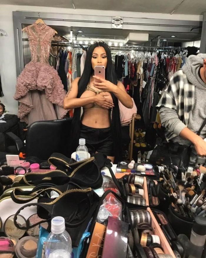 Nicki Minaj topless taking a mirror selfie