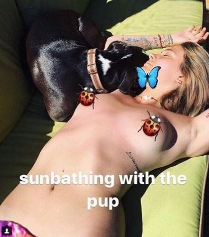 Paris Jackson topless in the sun with dog