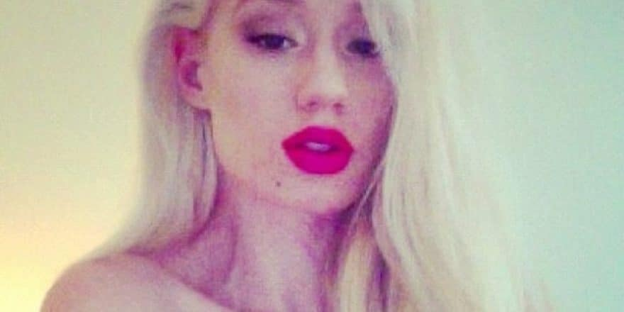 Singer Iggy Azalea with red lipstick on looking seductive