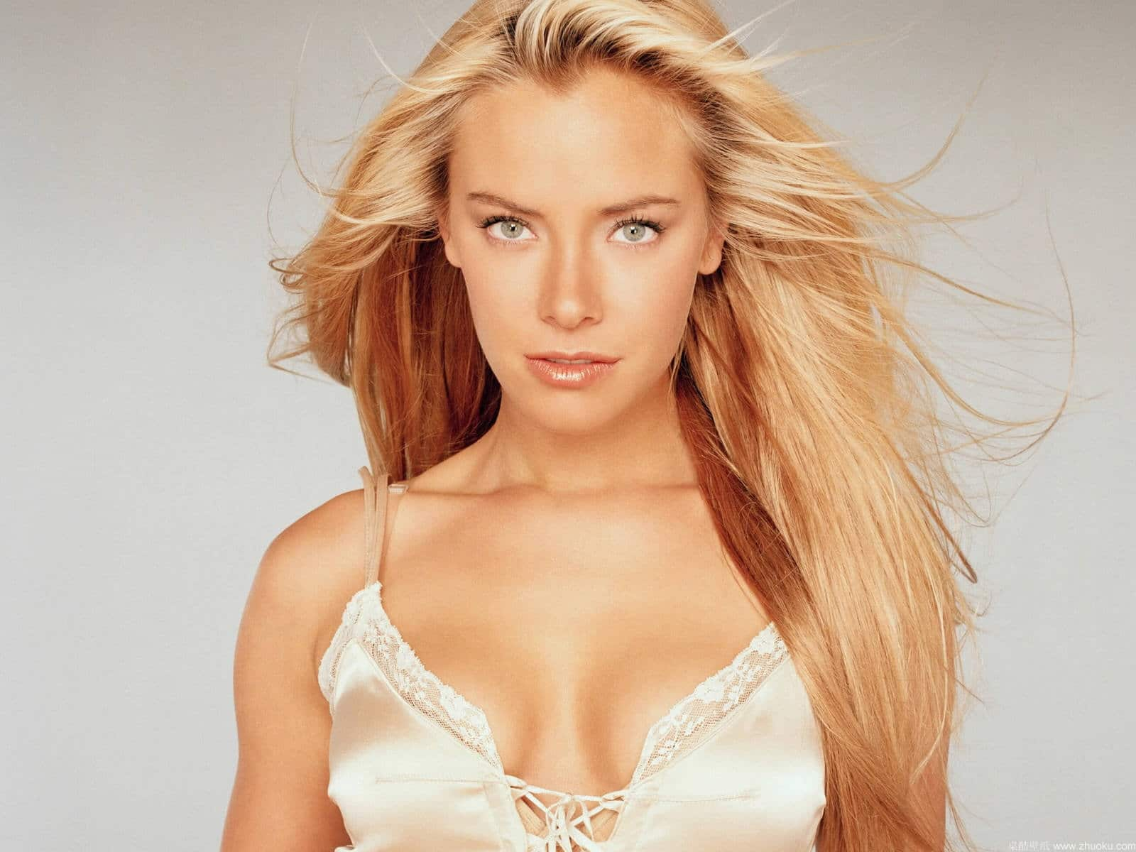 Kristanna Loken in silk cami showing cleavage