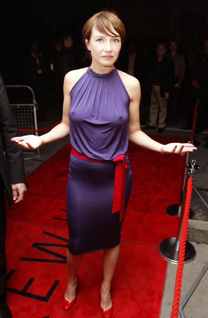 Carice van Houten wearing a purple dress nipples poking through