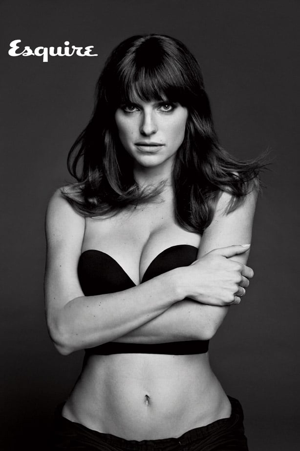 Black and white picture of Lake Bell crossing her arms and showing cleavage