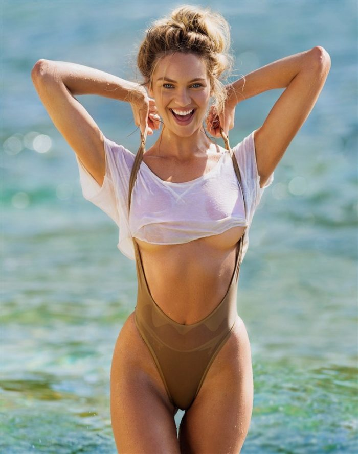 Candice Swanepoel in a sexy swimsuit under boob visible