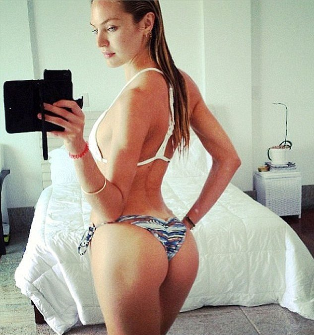 Candice Swanepoel taking a mirror selfie of her nice ass