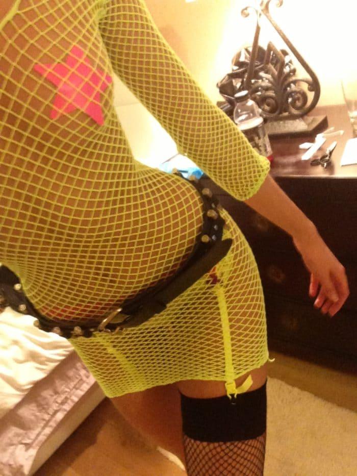 Candice Swanepoel wearing a yellow mesh dress