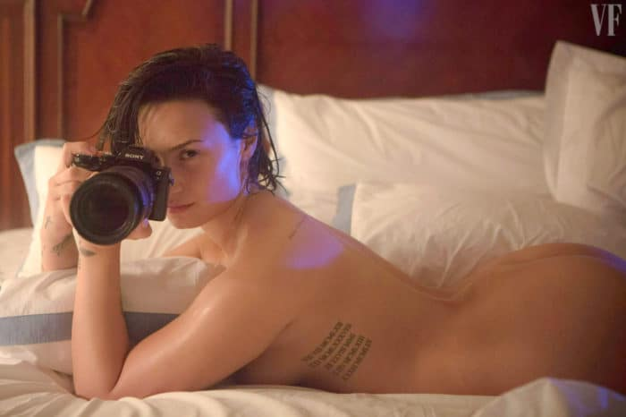Demi Lovato naked with a camera and butt in the air on bed