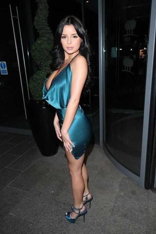Demi Rose Mawby in blue sheen dress suffers a nip slip