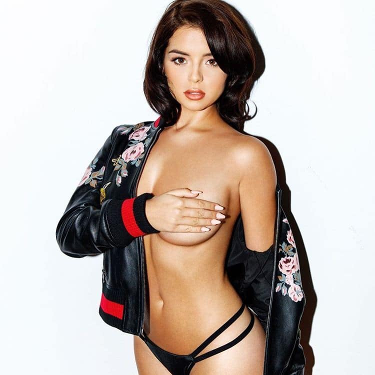 Demi Rose jacket off the shoulder covering tit with hand