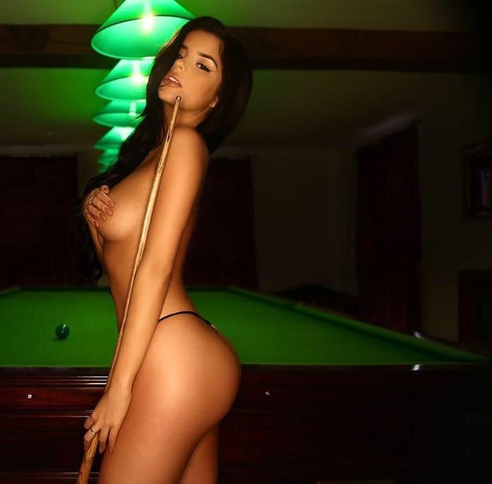 Demi Rose modeling with tits out and nipple stickers on