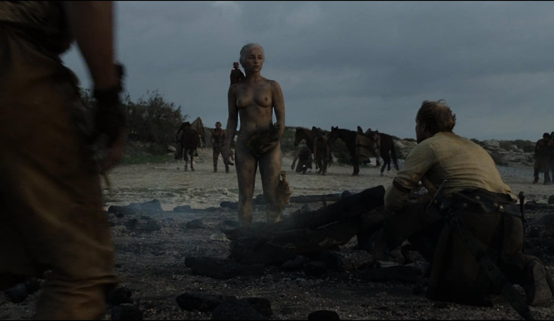 Emilia Clarke completely naked standing in ash