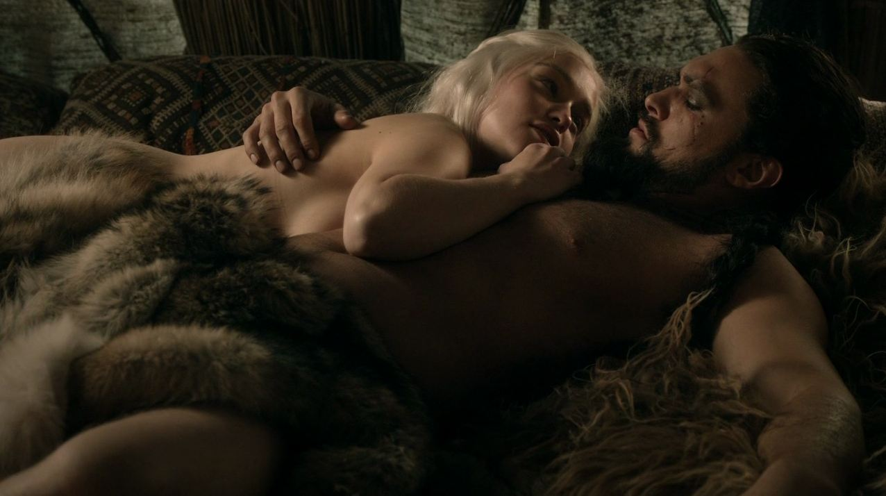 Emilia Clarke in the nude looking up at man in bed