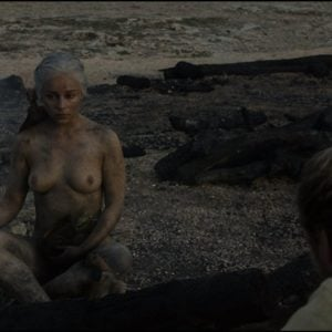 Emilia Clarke sitting down nude covered in ash