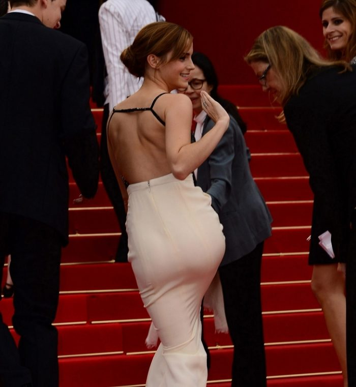 Emma Watson in tight gown showing off her bottom and waving