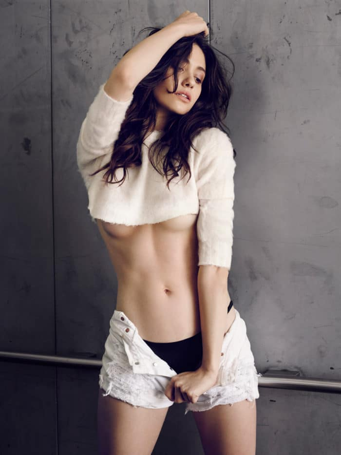 Emmy Rossum modeling for Esquire in cropped sweater showing her under boobs