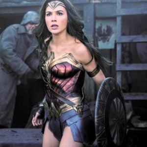 Gal Gadot as Wonder woman holding shield