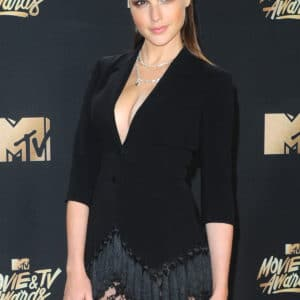 Gal Gadot in a black dress cleavage exposed