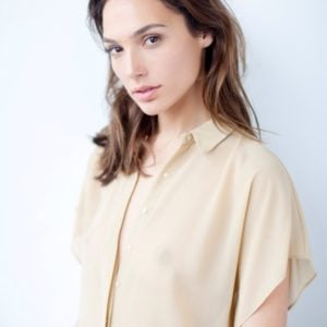 Gal Gadot in a yellow shirt nipples visible