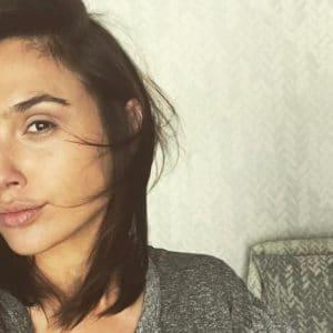 Gal Gadot taking a selfie in a grey shirt