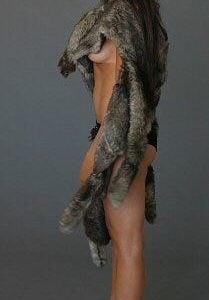 Gal Gadot wearing fur showing some under boob