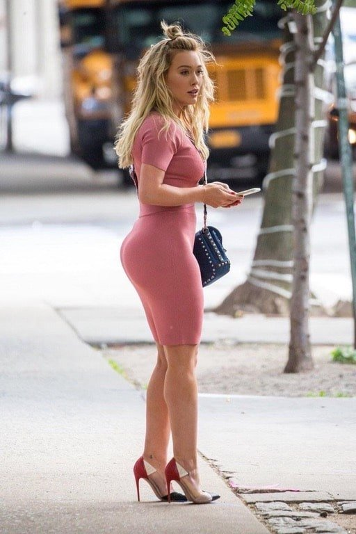Hillary Duff booty in pink dress with heels on